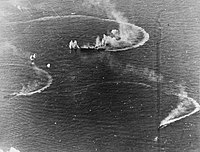 The Japanese aircraft carrier Zuikaku and two destroyers under attack in the Battle of the Philippine Sea