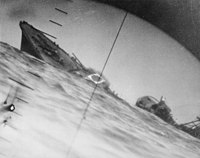 The torpedoed, as seen through the periscope of an American submarine,, in June 1942