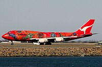 A Boeing 747-400ER in 2006 wearing the Wunala Dreaming livery. From 2003 to 2012, it was the second aircraft to carry the colour scheme.