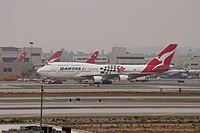 A Qantas Boeing 747-400 in Australian Grand Prix livery at Los Angeles International Airport (LAX) in 2011.
