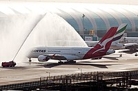 The first daylight arrival of a Qantas Airbus A380 at Dubai International Airport on 1 April 2013 is greeted with a water cannon salute.