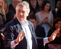 De Niro having his hand- and shoe-prints placed in cement at TCL Chinese Theatre in February 2013