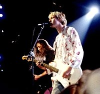 Kurt Cobain (foreground) and Krist Novoselic with Nirvana live at the 1992 MTV Video Music Awards.