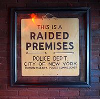 The sign left by police following the raid is now on display just inside the entrance