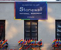 A banner hanging from the top of the building the day after President Obama announced creation of the Stonewall National Monument