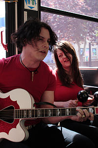 The White Stripes giving an impromptu show for fans on a bus in Winnipeg, Manitoba in 2007