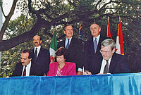 From left to right: (standing) President Carlos Salinas, President Bush, Prime Minister Brian Mulroney; (seated) Jaime Serra Puche, Carla Hills, and Michael Wilson at the NAFTA Initialing Ceremony, October 1992