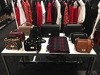 Bags designed by Ratajkowski for The Kooples on display at Bloomingdale's at 900 North Michigan
