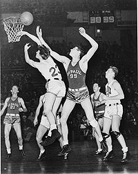"""Hall of Famer George Mikan (#99) led the Lakers franchise to their first five NBA championships. He is described by the NBA's official website as the """"first superstar"""" in league history."""