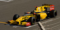 Robert Kubica driving for Renault at the 2010 Bahrain Grand Prix, bearing the distinctive yellow and black livery.