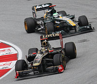 Nick Heidfeld leads Heikki Kovalainen (Team Lotus) at the 2011 Malaysian Grand Prix, Group Lotus's sponsorship of Renault in led to a court dispute over naming rights between the two teams.