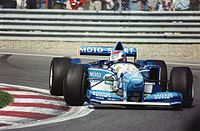 Johnny Herbert's Benetton-Renault during the 1995 Canadian Grand Prix. Renault won 16 races of 17 races in the season, with Benetton and Williams. It was the record for the most wins in a year as an engine supplier.