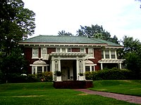 Pine Wold house (Fairfield Avenue at Kirby Street) was designed by Edward F. Neild, who created some of the designs for the interior of the White House in the Truman administration, as well as the Harry S. Truman Presidential Library and Museum. Pine Wold was constructed in 1903 by lumberman T. J. Jones and expanded in 1919 by oilman J. P. Evans. For a time the Mighty Haag Circus wintered on the grounds, and the circus elephant Trilby is buried there.