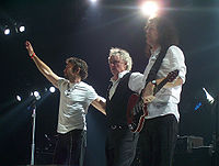 Queen performing with Paul Rodgers during their 2005 tour