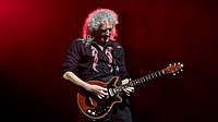 Brian May playing his custom-made Red Special at the O 2 Arena in London in 2017. He has used this guitar almost exclusively since the band's advent in the early 1970s.