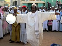 A Sufi dervish drums up the Friday afternoon crowd in Omdurman, Sudan