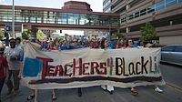 Teachers union members march for justice for Philando Castile on July 19, 2016