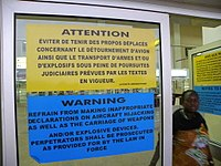 Warning posters in a Central African airport, June 2012