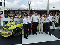 Toyota executives in front of the truck that won Toyota's first national series race.