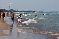 Lake Michigan's beaches, popular with tourists, are juxtaposed with heavy industry.