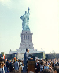 September 26, 1972: President Richard Nixon visits the statue to open the American Museum of Immigration. The statue's raised right foot is visible, showing that it is depicted moving forward.