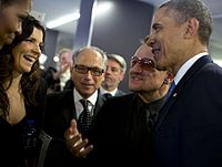 Bono (second from right) and his wife, Ali Hewson (second from left), with President Obama at Nelson Mandela's funeral in South Africa, December 2013