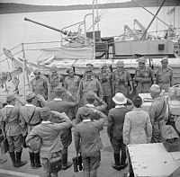 Japanese military delegation salute Lieutenant Colonel Nathu Singh, commanding officer of the Rajput Regiment, following their surrender of Islands, 1945