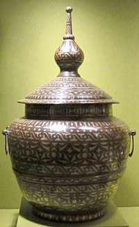 """A Muslim """"Food jar"""" from the Philippines, also known as gadur, well known for its brass with silver inlay."""