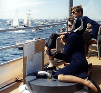 President and Mrs. Kennedy watching the 1962 America's Cup races off Newport