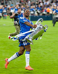 Didier Drogba holding the Champions League trophy after Chelsea's victory in 2012