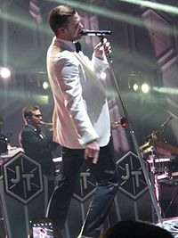 Timberlake performing during The 20/20 Experience World Tour, February 2014. It is Timberlake's highest-grossing tour and one of the highest grossing tours of the decade