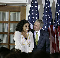 US President George W. Bush congratulates Sparks after she sang the U.S. national anthem during the welcome for President Bush and Laura Bush to the Ambassador's Residence in Ghana