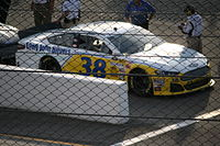 David Gilliland in the No. 38 at the 2013 Toyota Owners 400.