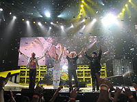 Van Halen onstage with Roth and Wolfgang in 2008.