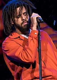 Cole performing in 2017