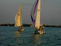 Sailboats approaching the south shore of Lake Mendota and downtown Madison – north side of isthmus
