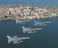 The skyline of Madison, with Wisconsin ANG F-16 jet fighters in the foreground