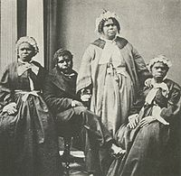 Four elderly full-blood Tasmanian Aboriginal people, c. 1860s. Truganini, for many years claimed to be the last full-blood Aboriginal person to survive, is seated far right.