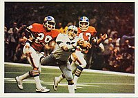 The Cowboys playing against the Broncos in Super Bowl XII.