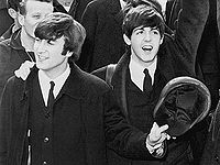 Lennon (left) and McCartney (right) in 1964