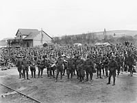 3rd Division soldiers waiting for a train at Gamaches railway station at the start of their journey back to Australia in April 1919