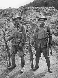 Two soldiers from the 5th Division immediately after leaving the front line in France during July 1918. The uniform and equipment of the soldier on the left, Private George Giles, has been on display at the Australian War Memorial since the 1920s.