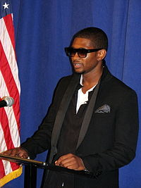 Usher giving a speech at the Service Nation Summit in 2008