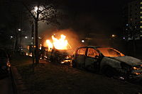 Second day of the Stockholm Husby riots. The picture shows three cars on fire in the Stockholm suburb of Husby, 20 May 2013