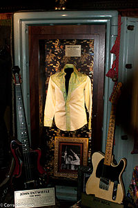 Display of Entwistle's bass guitar along with a shirt formerly owned by bandmate Keith Moon at the Hard Rock Cafe, London