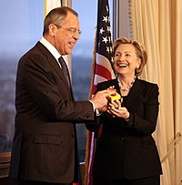 """Russian Foreign Minister Sergey Lavrov and Clinton hold a """"reset button"""", March 2009"""