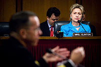 Clinton listens as the Chief of Naval Operations, Admiral Michael Mullen, responds to a question during his 2007 confirmation hearing with the Senate Armed Services Committee