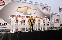 Wood joins sailors during a special pre-race reenlistment ceremony at Texas Motor Speedway Fort Worth, Texas, (September 13, 2002)
