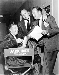 Hope (right) with his brother Jack (seated), who produced his early 1950s show, with comedian Jack Benny