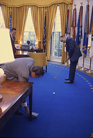 Hope, a golf fan, putting a golf ball into an ashtray held by President Richard Nixon in the Oval Office in 1973